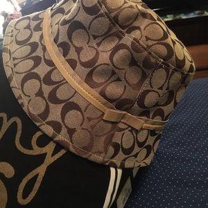 Coach Bucket hat. Tan brown signature logo.